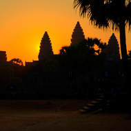 The rising sun still silhouettes Angkor Wat.