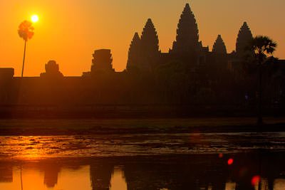 Thumbnail image ofThe sun rises over Angkor Wat and the pond on...