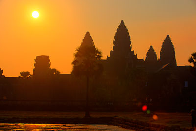 Thumbnail image ofWhite ball of sun over Angkor Wat and the pond...