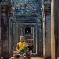 Sitting Buddha image in Bayon in the Angkor Thom complex.