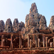 Panorama of the many faces of Bayon in the Angkor Thom complex.