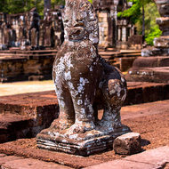 Defaced lion at the Elephant Terrace in the Angkor Thom complex.