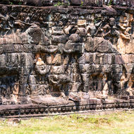 Bas relief of elephants and warriors at the Elephant Terrace in the Angkor Thom complex.