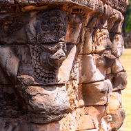 Weathered bas reliefs at the Elephant Terrace in the Angkor Thom complex.