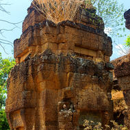 Crumbling small laterite temple in the jungle.