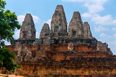 Thumbnail image of Preah Rup temple complex rising up from the flat...