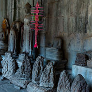 Standing Buddha image in the Gallery of 1000 Images of Lord Buddha and other looted images in Angkor Wat.