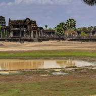 The southern pond in the outer courtyard of Angkor Wat and the southern outer library in front of the causeway and main western entrance.