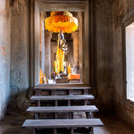 Standing Buddha image in the western entrance towers gallery of Angkor Wat.
