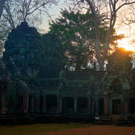 Sun rising over Ta Prohm, from the western side looking at the entrance towers of enclosure III.