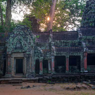 Sun rise at Ta Prohm, from the western side looking at the entrance towers of enclosure III.