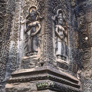 Intact bas relief of Apsara dancers on a central tower at Ta Prohm.