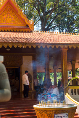 Thumbnail image ofMonks receiving alms behind a screen of incense...