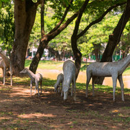Grazing: statues beside the Siem Reap River.