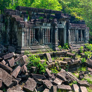 Library building still stands amid other fallen masonry within the outer enclosure of Beng Mealea temple.
