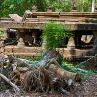 East entrance causeway of the Beng Mealea temple in disarray.