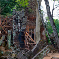 Prasat Thom temple; eastern entrance tower and collapsed outer wall.