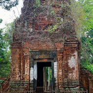 Brick constructed eastern entrance tower of Prasat Thom temple with one guarding lion, at the Koh Ker temple complex.