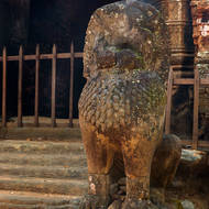 Defaced guarding lion at the eastern entrance tower of Prasat Thom temple.