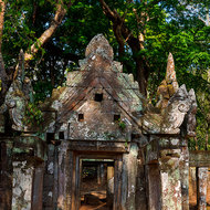 Entrance portico of Prasat Kra Chap temple in the jungle.