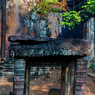 Low doorway and lintel at Prasat Banteay Pir Chean temple.