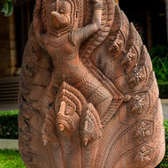 Naga head statue in front of a hotel.