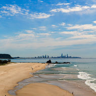Currumbin surf beach, the mouth of Currumbin Creek and Surfers Paradise in the distance.
