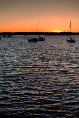 Thumbnail image of Last light of sunset silhouettes the yachts on...
