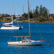 Yachts moored on the Clarence River, center foreground one needs a lot of maintenance.