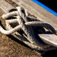 Rope tie on a jetty bollard.