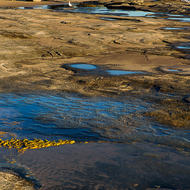 Tidal pools and beach at low tide.