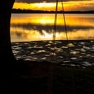 Not much action yet at the rubber tire swing as the sun rises over the Clarence River.