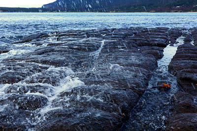 Thumbnail image ofSmall waves break over the Tessellated Pavement.
