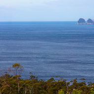 Panoramic view from Pirates Bay lookout southward towards Hippolyte Rocks and Cape Huay.