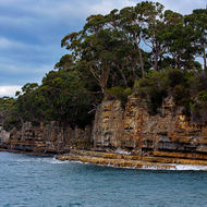 Layered sandstone cliffs of Point Puer, the site of the boys' prison associated with Port Arthur convict prison.
