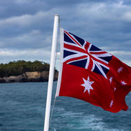 Australian maritime flag flies on the ferry to the Isle of the Dead.