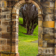 Arched doorway in a sandstone wall.