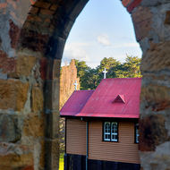 St David's church through the arched side door of Port Arthur prison church.
