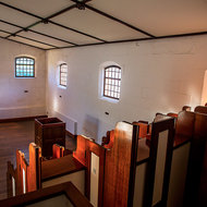 Separate Prison chapel, separate partitions for each prisoner.