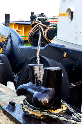 Thumbnail image ofInteresting. Bollard with tug boat attached in...