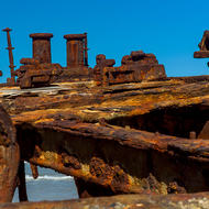 Rusting deck structure and bollard of the wrecked ship Maheno.