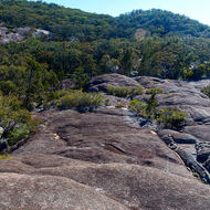 Bare exposed granite plateau through which Bald Rock Creek has cut its way to emerge as Underground Creek.