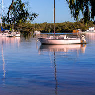 Yachts on Noosa River in the morning calm.