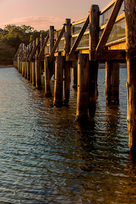 Thumbnail image ofFootbridge over Deep Creek in the light of the...