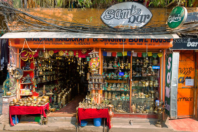 Thumbnail image ofHandicraft and singing bowl shop, topped by Sam's...