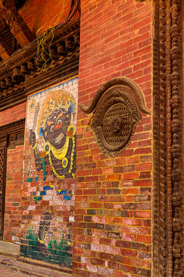 Thumbnail image ofDecorative woodwork and wall art on old building.