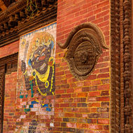 Decorative woodwork and wall art on old building.