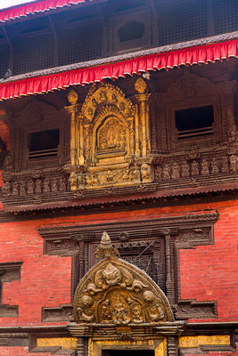 Thumbnail image ofIntricate wood carvings of windows and over door...
