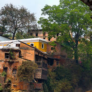Buildings along the Bagmati River at the Pashupati temple complex and cremations site.