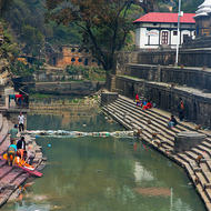 Part of the cremation site on the Bagmati River at the Pashupati temple, a recently deceased is brought to the river for a ritual washing.